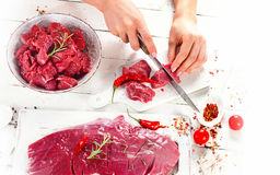 Woman hands cutting beef Stock Photos