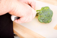 Woman hands cutting broccoli Royalty Free Stock Image
