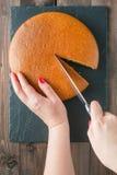 Woman hands cutting manna pie Stock Image