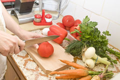 Woman hands cutting ripe tomato Stock Photography