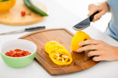 Woman hands cutting vegetables Stock Photography