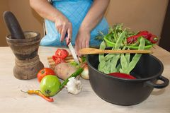 Woman hands cutting vegetables on kitchen blackboard. Healthy food. Woman preparing vegetables, cooking healthy meal in the kitche Stock Photography