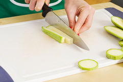 Woman hands cutting zucchini Stock Photography