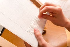 Woman hands doing cross-stitch. Stock Image