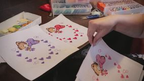 Woman hands doing embroidery cross-stitch stock video footage