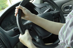 Woman hands driving a car Stock Photography