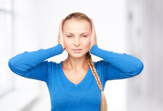 Woman with hands on ears Stock Photography