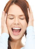Woman with hands on ears Royalty Free Stock Photography