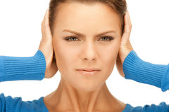 Woman with hands on ears. Picture of woman with hands on ears stock image