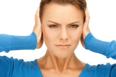 Woman with hands on ears Royalty Free Stock Image