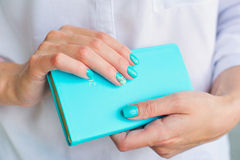 Woman hands with elegant turquoise manicure Stock Photos