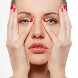 Woman with hands on face Royalty Free Stock Images