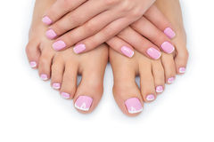 Woman hands and feet with french manicure stock image