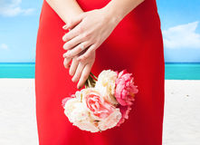 Woman hands with flowers and ring Royalty Free Stock Photography