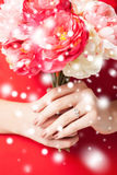 Woman hands with flowers and ring Stock Images