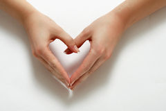 Woman hands formming a heart Stock Photo