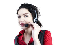 Woman with hands free. Pretty operator of call center has conversation with client royalty free stock photos