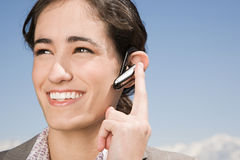 Woman with hands free device Royalty Free Stock Image