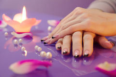 Woman hands with french manicure with crystals Stock Images
