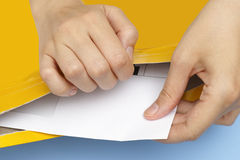 Woman hands getting out white envelope Stock Photo