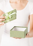 Woman hands with gift box Royalty Free Stock Image