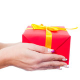 Woman hands giving a gift Royalty Free Stock Photos