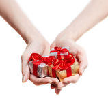 Woman hands giving gifts isolated on white Royalty Free Stock Photography