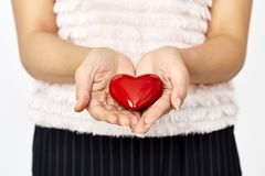 woman hands giving heart love and sharing concept Stock Image
