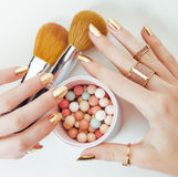 Woman hands with golden manicure and many rings Royalty Free Stock Photography