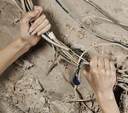 Woman hands grabbing wires to tear it Royalty Free Stock Images