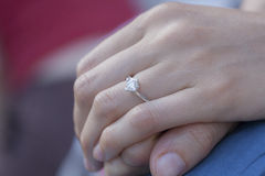 Woman hands. A woman hand wearing a diamond ring Royalty Free Stock Image