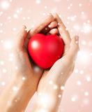 Woman hands with heart. Health, love and charity concept - woman hands with heart Stock Photo