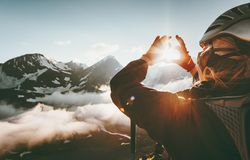 Woman hands Heart symbol shaped Travel Lifestyle. And Feelings concept with sunset mountains on background Stock Image