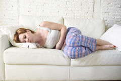 Woman with hands on her belly or tummy suffering stomach cramp and period pain Stock Photo