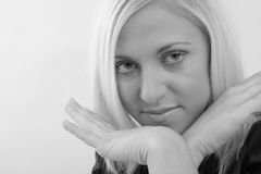 Woman with hands by her face Stock Photo