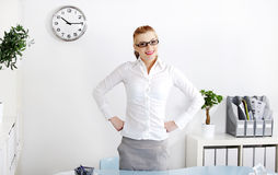 Woman with hands on her hips. Royalty Free Stock Photography