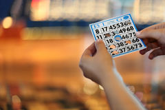 Woman Hands Hold Bingo Card With Holes Stock Photos