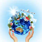 Woman hands hold Earth with buildings and airplane Stock Photo