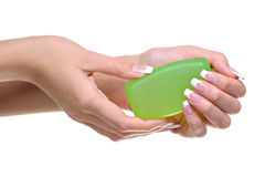 Woman hands hold the green soap Royalty Free Stock Photography