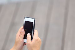 Woman hands hold smart phone Stock Image