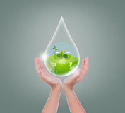Woman hands hold water drop Royalty Free Stock Photo