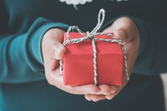 Free Woman Hands Holding A Christmas Gift Red Box. Stock Photos - 85905093