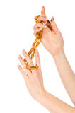 Woman hands holding amber necklace Stock Photography