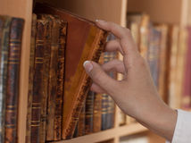Woman Hands holding ancient books Royalty Free Stock Photo