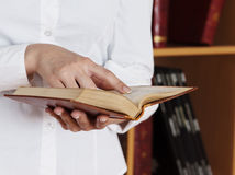 Woman Hands holding ancient books stock photo