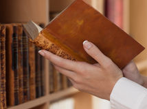Woman Hands holding ancient books Royalty Free Stock Photography