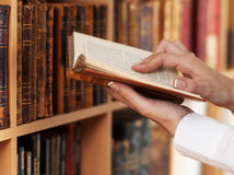 Woman Hands holding ancient books Royalty Free Stock Images