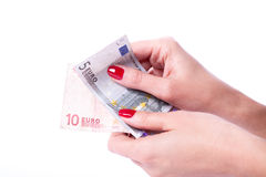 Woman hands holding banknotes of euro Royalty Free Stock Images