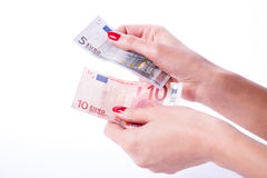 Woman hands holding banknotes of euro Royalty Free Stock Photography