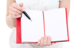 Woman hands holding blank notebook and pen isolated on white Royalty Free Stock Photos